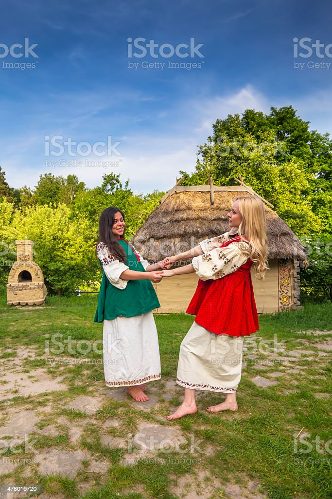 Two young ukrainian women in national costumes stock photo