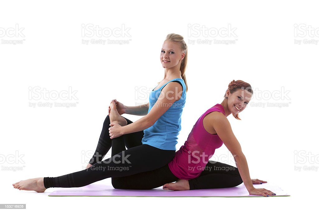 two young woman doing stretch exercise isolated royalty-free stock photo