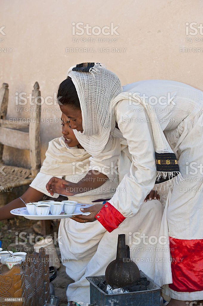 Two young woman in a traditional coffee ceremony, Ethiopia royalty-free stock photo