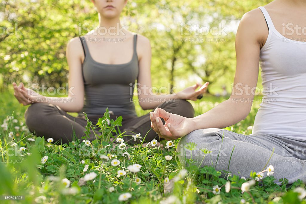 Two young woman meditation royalty-free stock photo