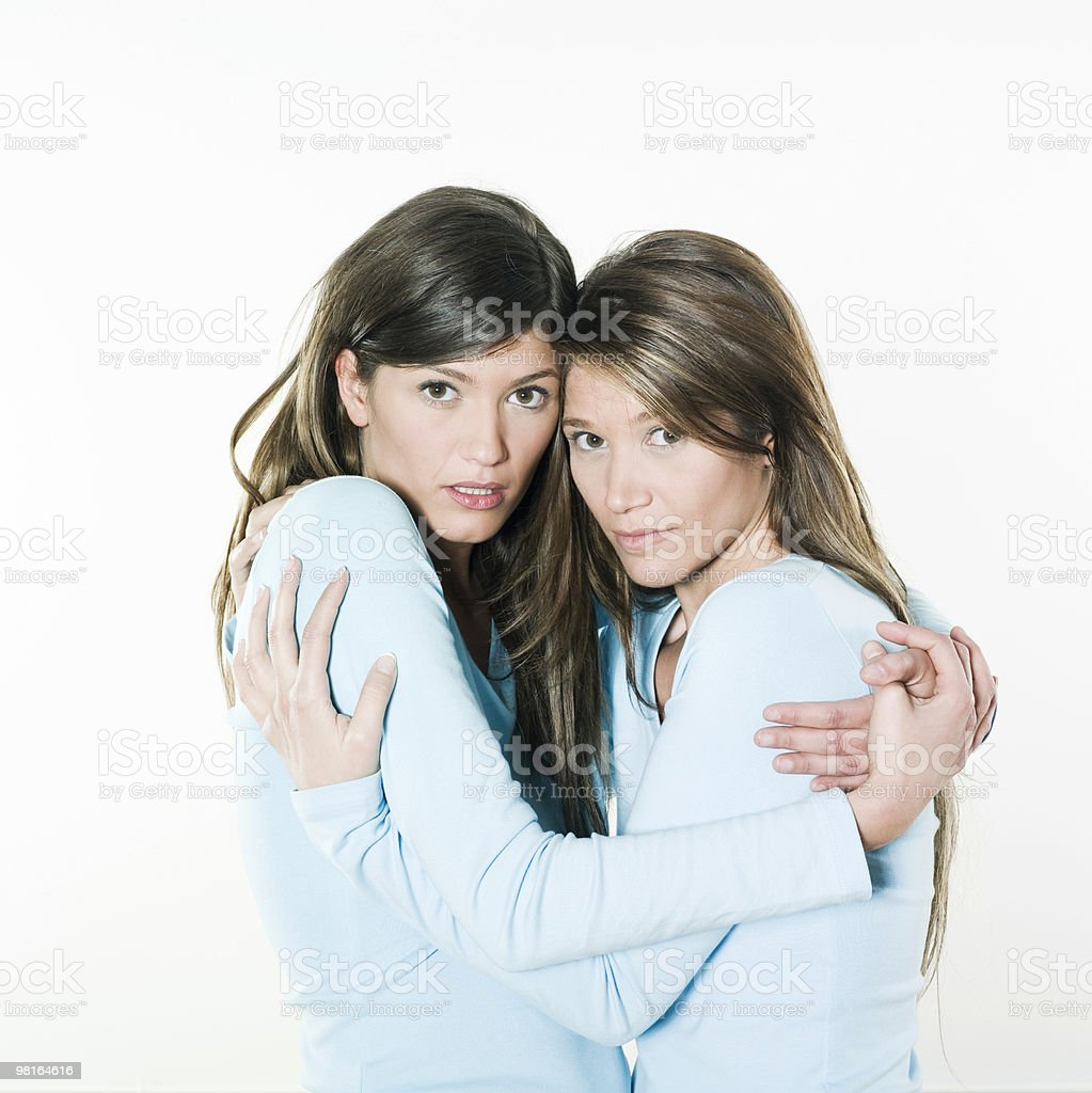 two young woman sister portrait huging afraid royalty-free stock photo