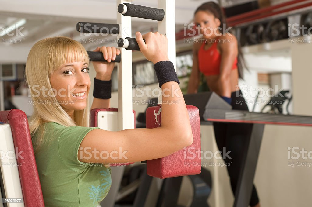 two young woman training in the gym royalty-free stock photo