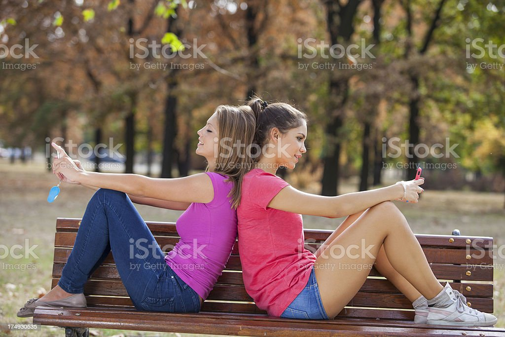 Two young woman with mobile phone royalty-free stock photo