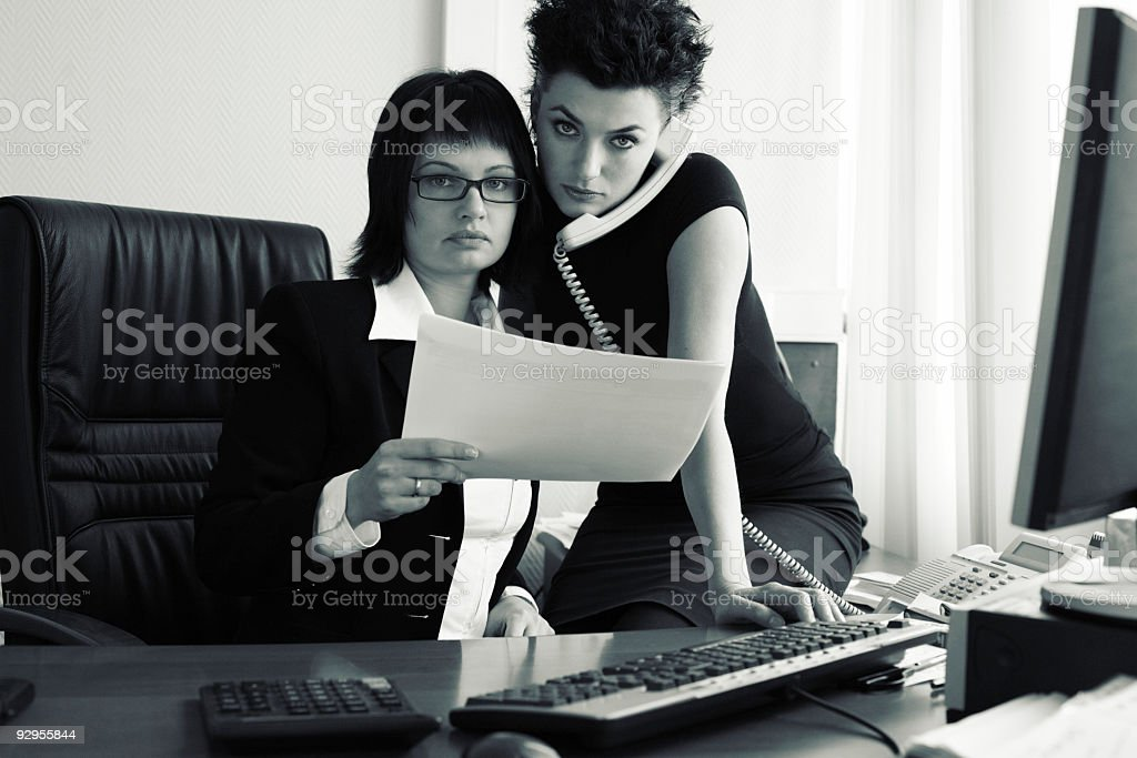 two young woman working in office stock photo