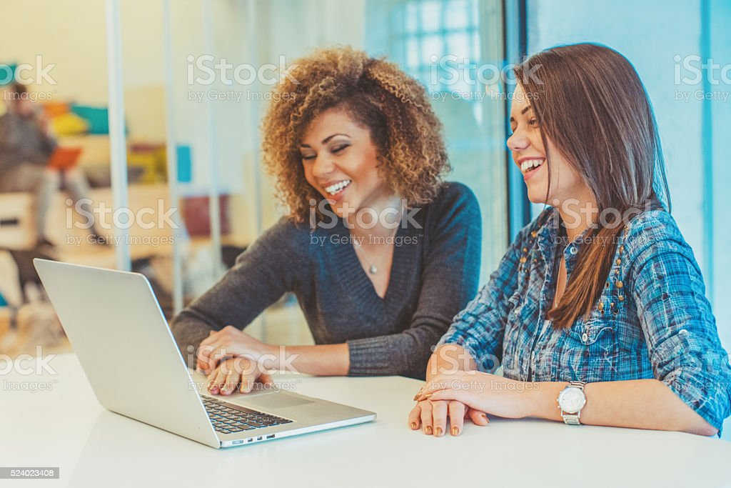 two young women at the office stock photo