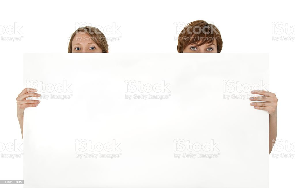 Two young women behind a blank banner ad royalty-free stock photo