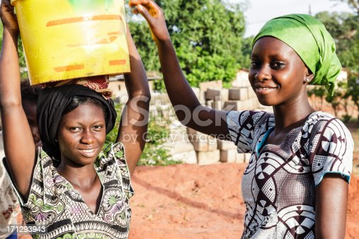istock Two young women carrying water in Africa 171293943