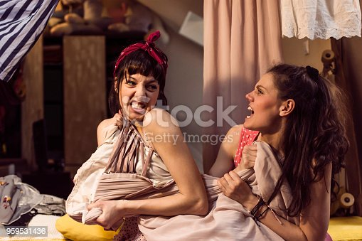 969532194 istock photo Two young women choosing their outfit 959531436