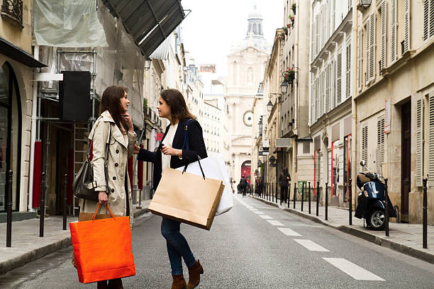 Two young women discussing in the middle of the street stock photo