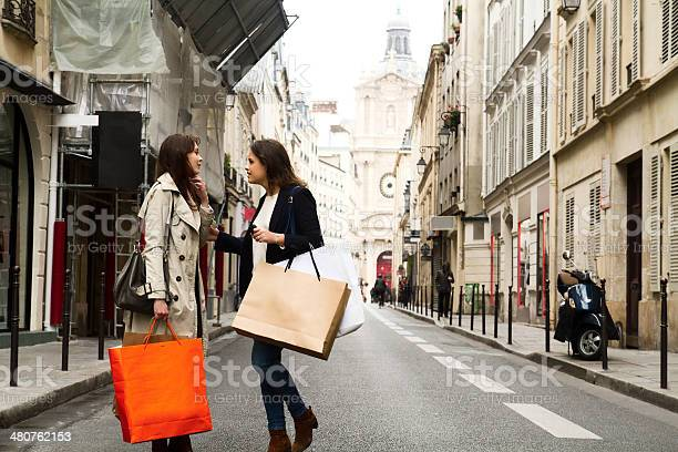 Two Young Women Discussing In The Middle Of The Street Stock Photo - Download Image Now