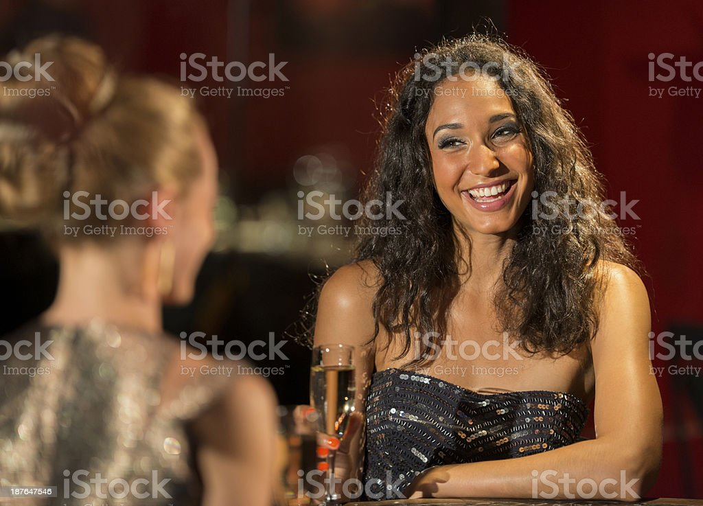 Two Young Women Drinking At A Bar royalty-free stock photo