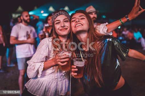 Two young women enjoying a night at the music festival