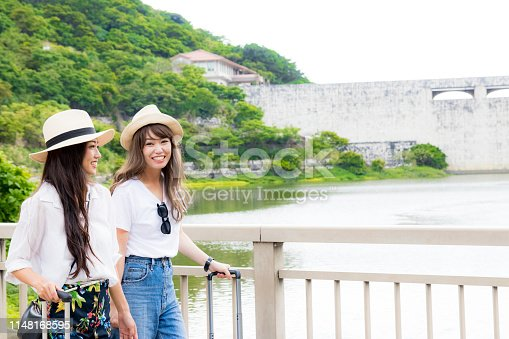 Two young women enjoying a trip. Travel around Japan and enjoy nature.