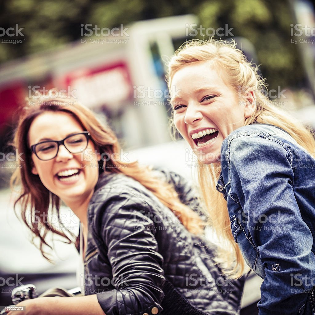 Two Young Women Enjoying Cycling Together, Soft Focus Image royalty-free stock photo