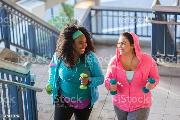Two young women exercising powerwalking up stairs picture id647090176?b=1&k=6&m=647090176&s=612x612&h=ycawqfbnmzx9egztht0apzbxkfaarywdmiqxg7ounji=