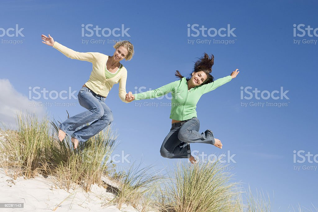 Two young women having fun at beach royalty-free stock photo