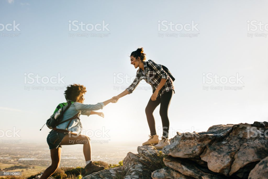 Two young women hiking in nature stock photo