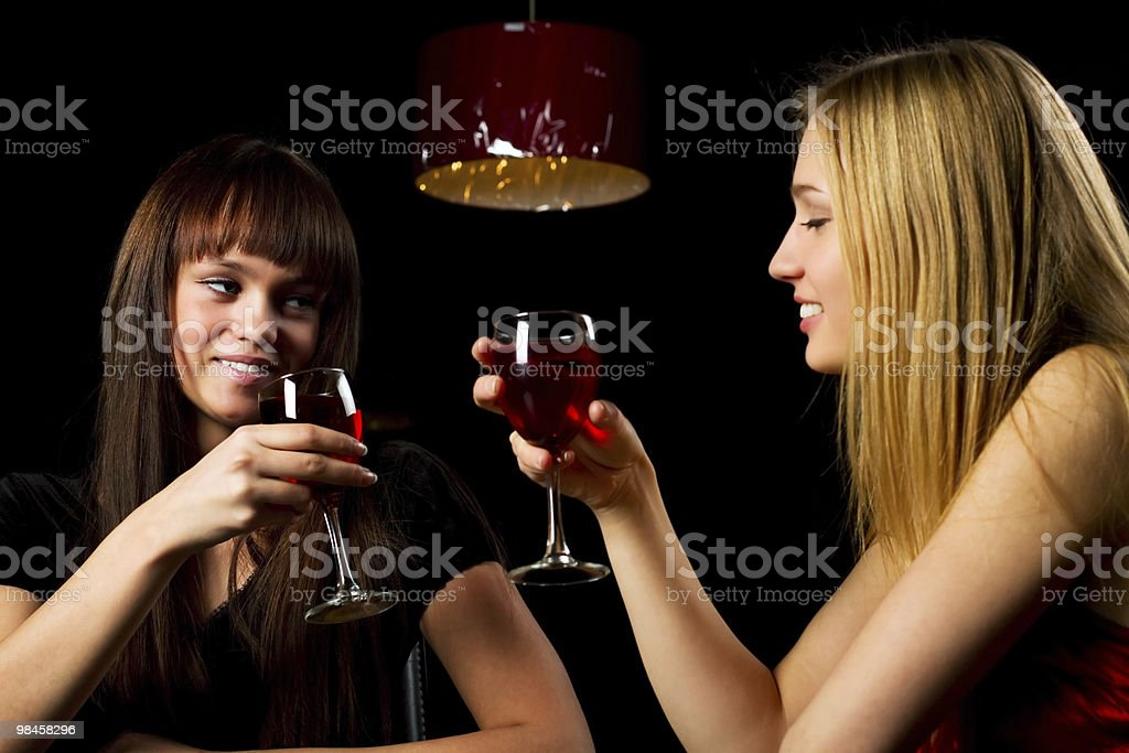 Two young women in a night bar royalty-free stock photo