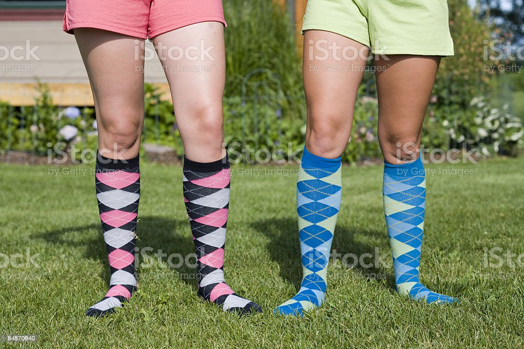 Two young women in argyle socks. royalty-free stock photo