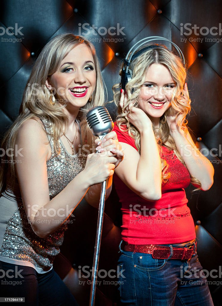 Two young women in music studio stock photo