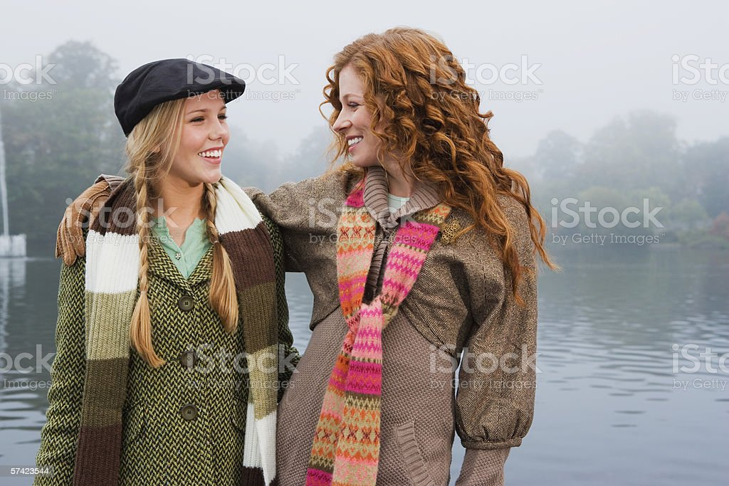 Two young women in park stock photo
