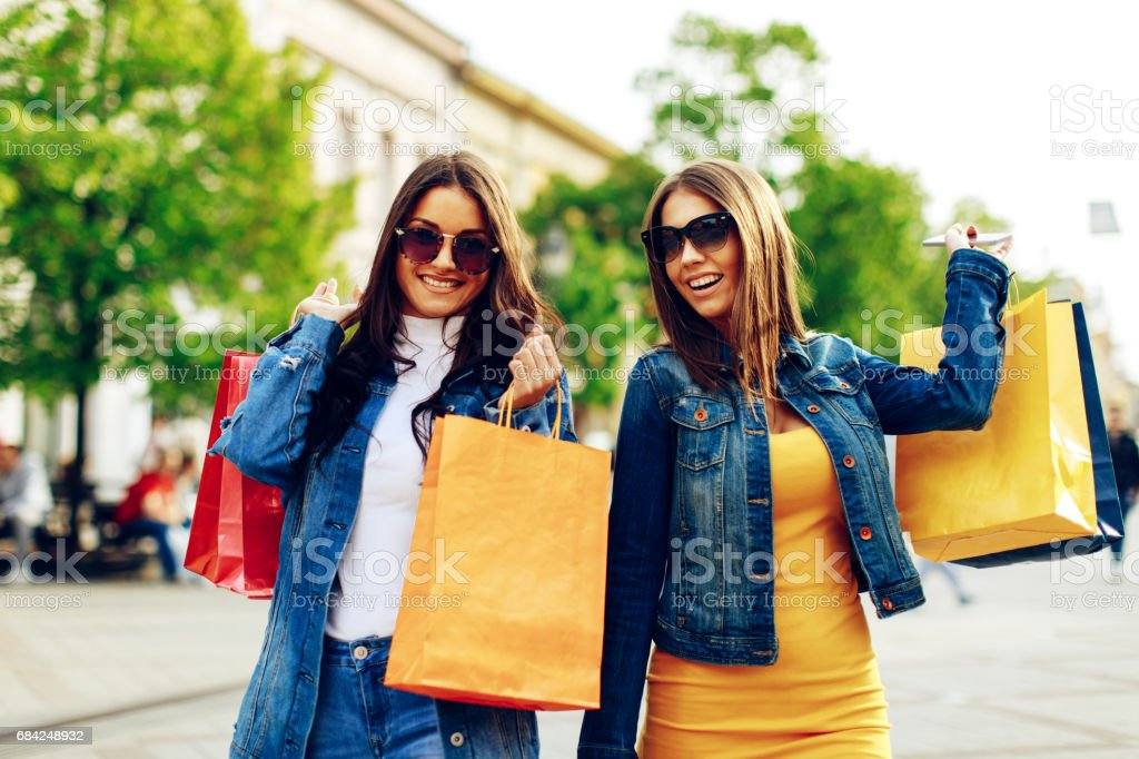 Two young women in shopping in the city royalty-free stock photo