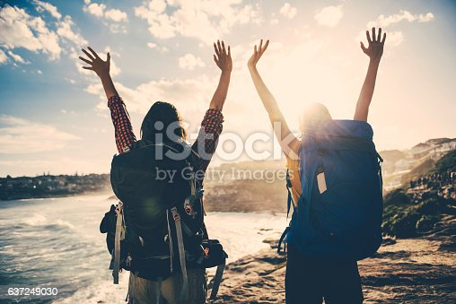 istock Two young women on vacation enjoying the sunset 637249030
