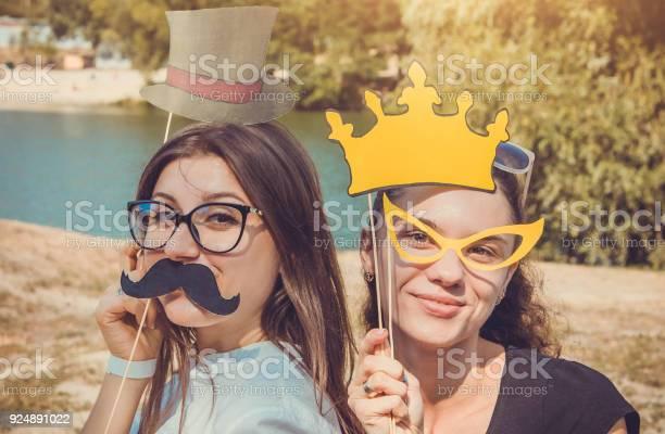 Two young women posing using photo booth props picture id924891022?b=1&k=6&m=924891022&s=612x612&h=r1gg7omzi2yshj7j3yj7kvzbnhvghw2o9xmsk5rbkgu=