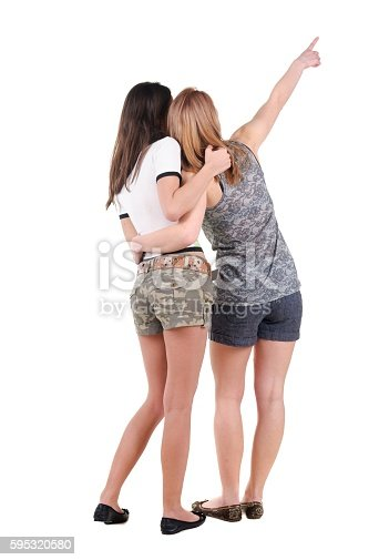 istock Two young women rear view. 595320580