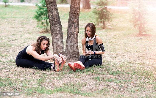istock Two young women resting after training 607908058