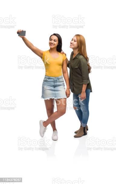 Two young women taking a selfie picture id1134378257?b=1&k=6&m=1134378257&s=612x612&h=kxny5yhak9hawakefz64 ova ety 2vuncqpfza2xta=