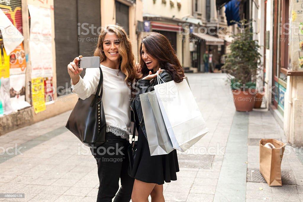 Two young women taking selfie stock photo