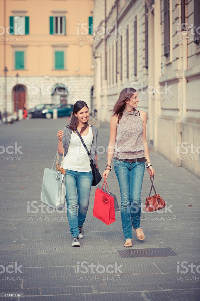 Two Young Women Walking in the City royalty-free stock photo
