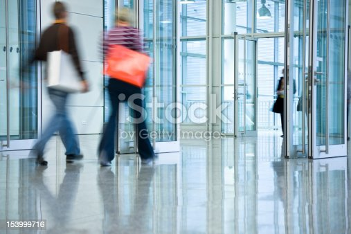 two blurred women walking with shopping bags
