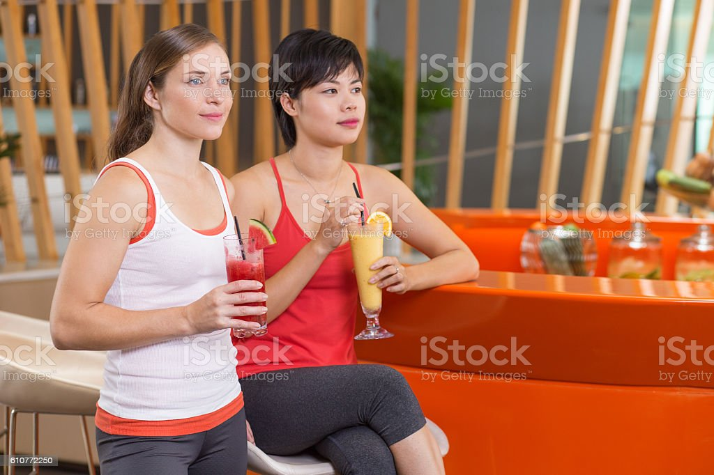Two Young Women with Smoothies in Sport Bar stock photo