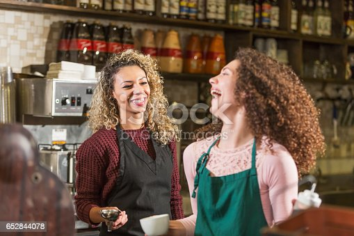 istock Two young women working in coffee shop 652844078