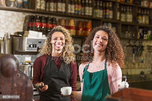 istock Two young women working in coffee shop 652844104