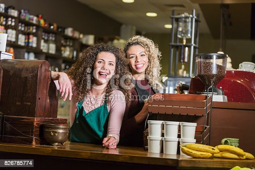 istock Two young women working in coffee shop 826785774
