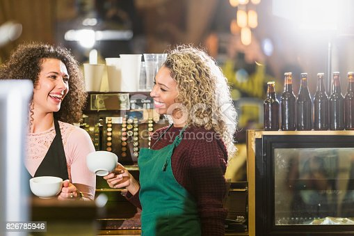 istock Two young women working in coffee shop 826785946