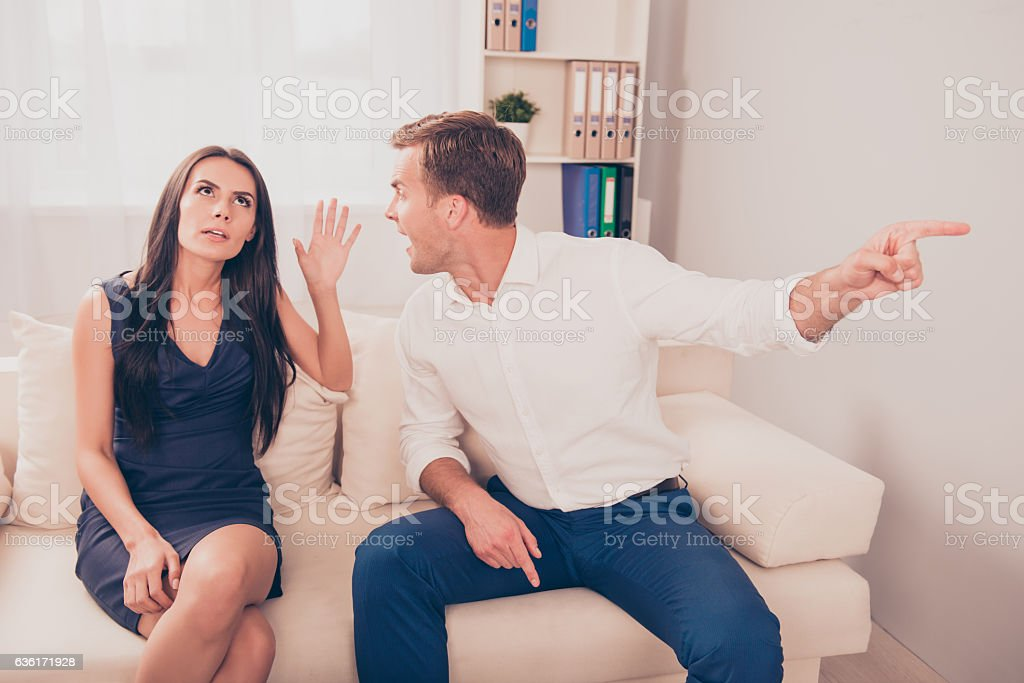 two young workers quarrel because of disagreements stock photo