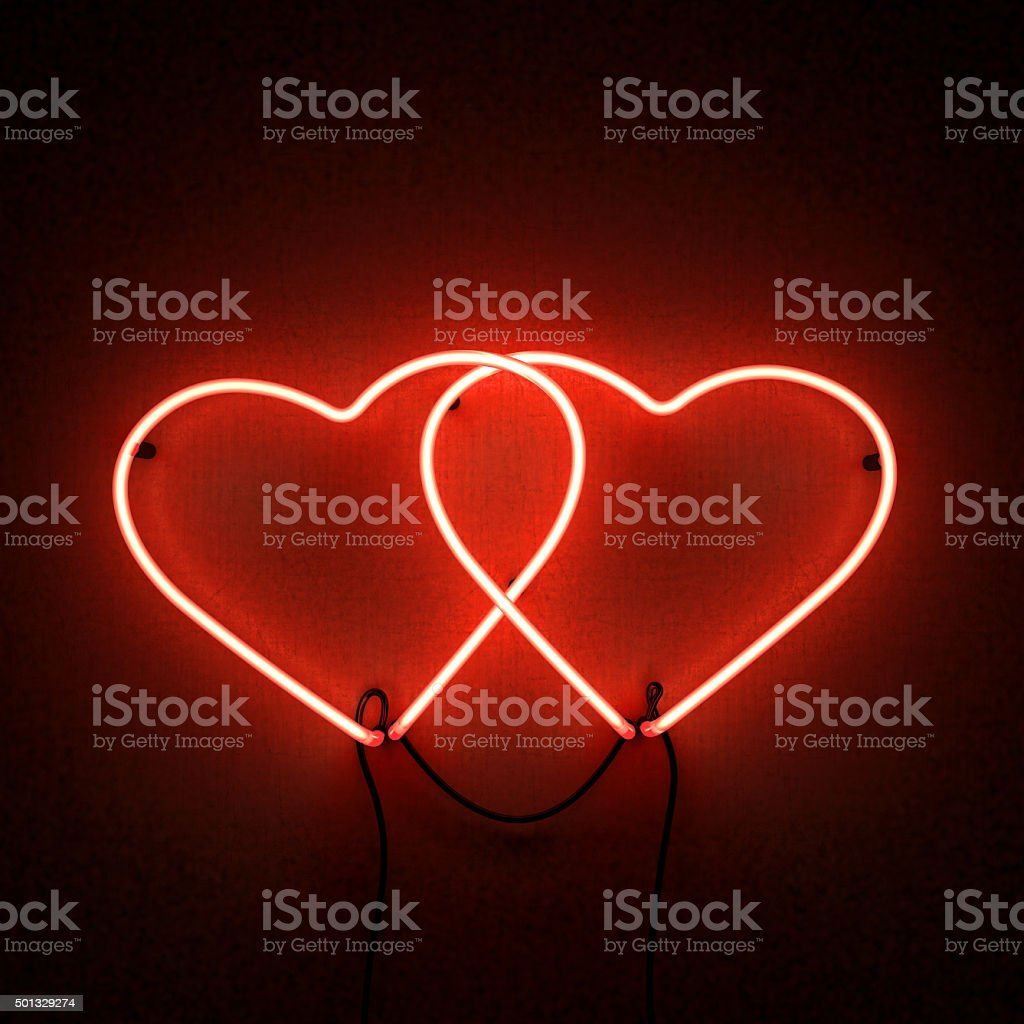 two_bound_heart_shaped_neon_lights stock photo