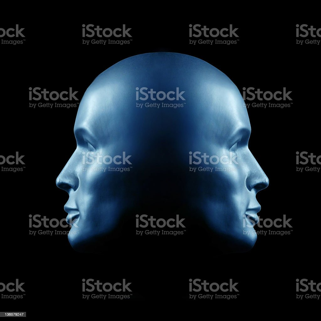 Two-faced head statue stock photo