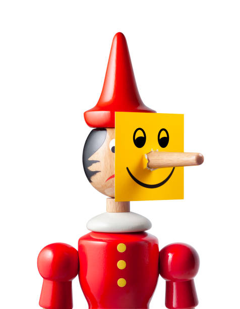 Two-faced. Sad Pinocchio with smiley face. Photo with clipping path. Pinocchio on white background. pinocchio stock pictures, royalty-free photos & images