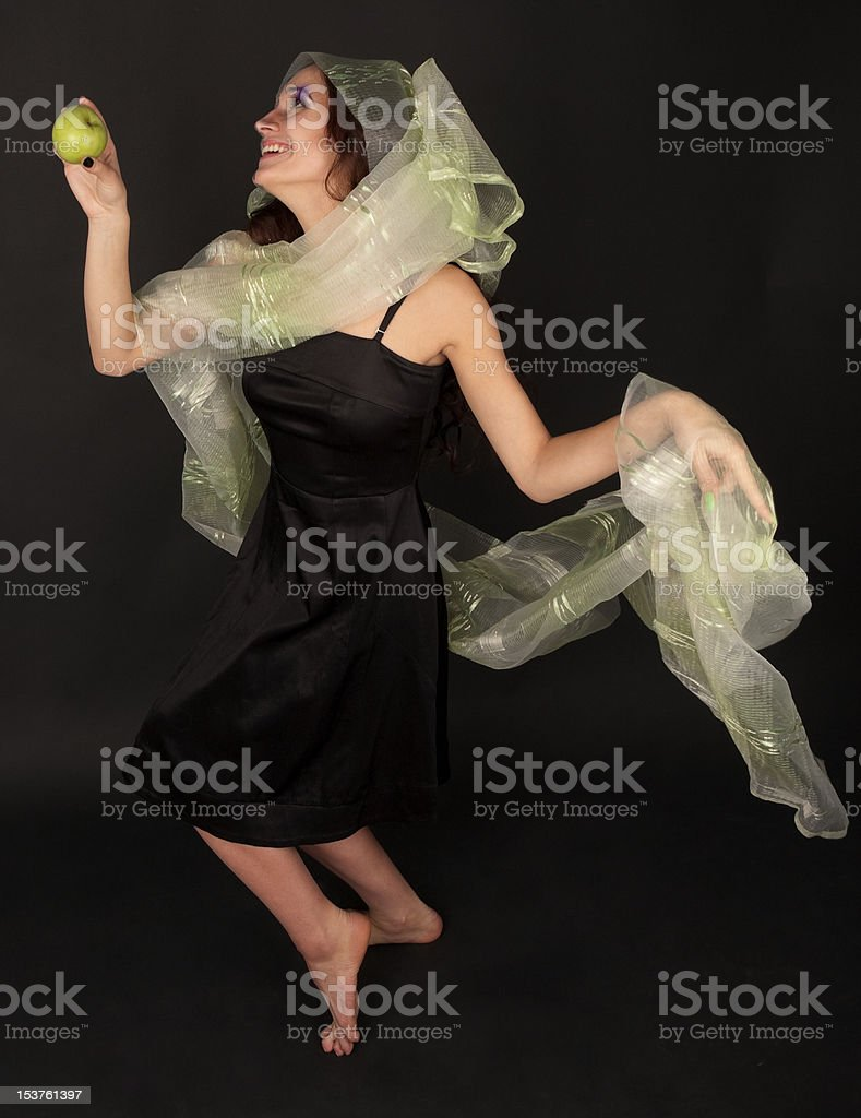 Two-faced woman with green apple dancing royalty-free stock photo