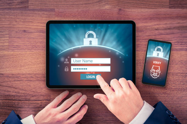 Two-factor authentication (2FA) and face identification stock photo