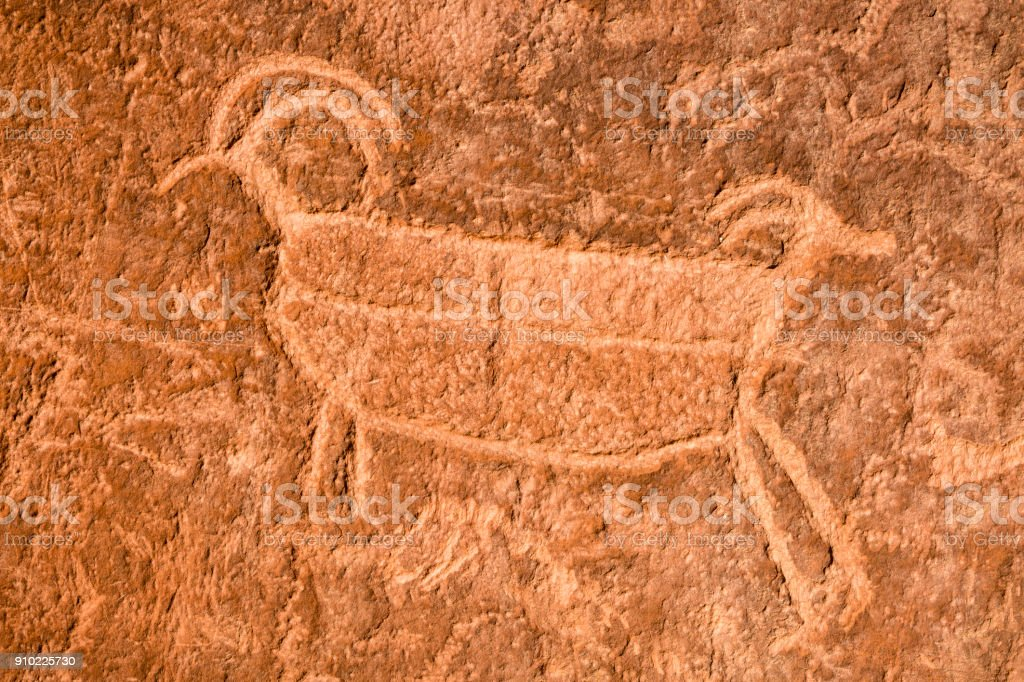 Two-Headed Big Horn Sheep Petroglyph stock photo