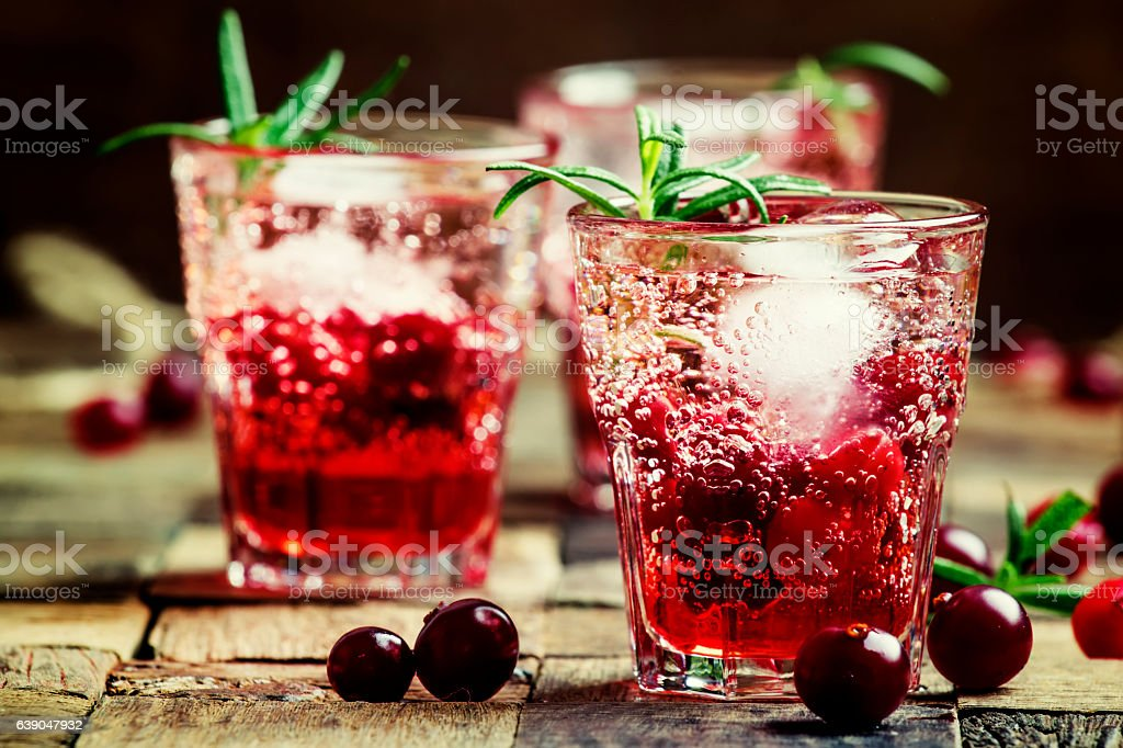 Two-layer cocktail with cranberry, vodka, rosemary stock photo