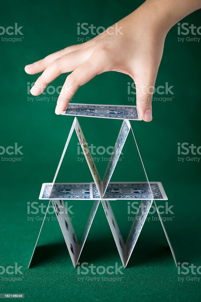 Two-layer solitaire tower in green background stock photo
