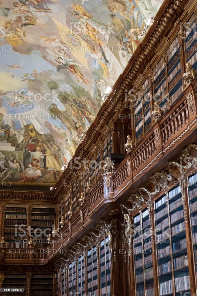 Two-storey bookshelf of Theological Hall inside the Library of the Strahov Monastery in Prague, with fresco ceiling. stock photo