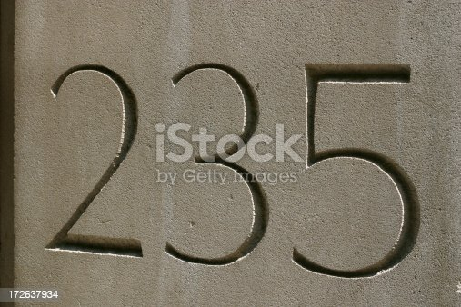 235 carved in concrete